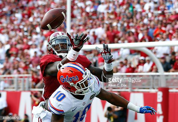 Landon Collins of the Alabama Crimson Tide nearly picks off this pass intended for Valdez Showers of the Florida Gators at BryantDenny Stadium on...