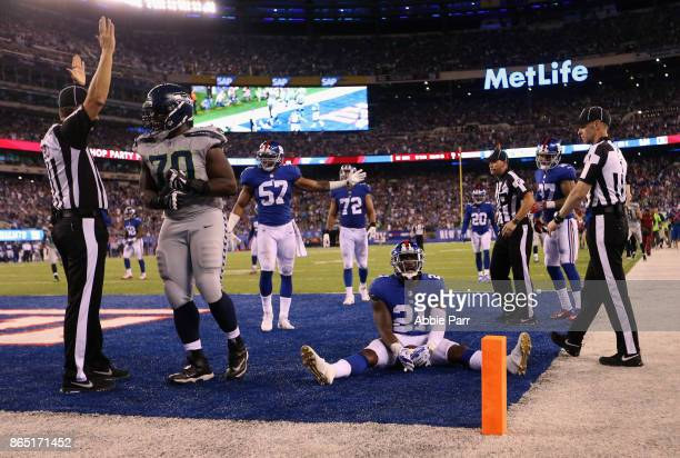 Landon Collins of the New York Giants and teammates react after Paul Richardson of the Seattle Seahawks scored a touchdown during the fourth quarter...