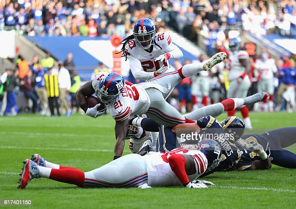 Landon Collins of the New York Giants scores a touchdown during the NFL International Series match between New York Giants and Los Angeles Rams at...