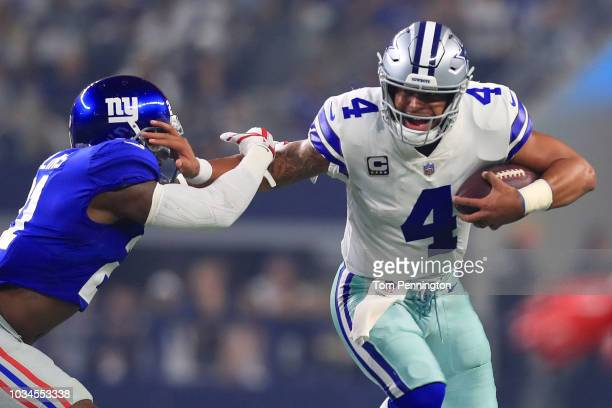 Landon Collins of the New York Giants tries to grab Dak Prescott of the Dallas Cowboys in the first quarter of a football game at ATT Stadium on...