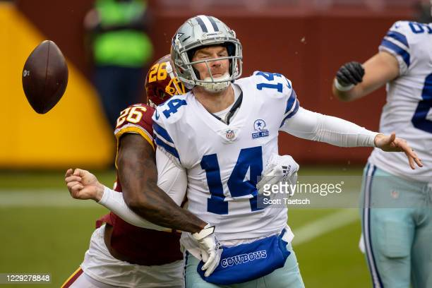 Landon Collins of the Washington Football Team strips the ball from Andy Dalton of the Dallas Cowboys during the first half at FedExField on October...