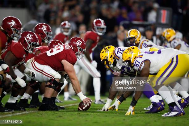 Landon Dickerson of the Alabama Crimson Tide lines up across Tyler Shelvin of the LSU Tigers at the line of scrimmage during the second half at...