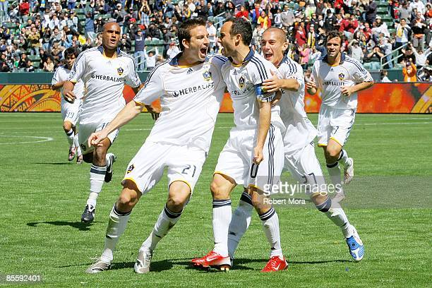 Landon Donovan Alan Gordon and Bryan Jordan of the Los Angeles Galaxy celebrate scoring the game tying goal against DC United during the MLS game at...
