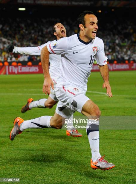 Landon Donovan and Benny Feilhaber of USA celebrate Donovan's winning goal against Algeria 10 during the 2010 FIFA World Cup South Africa Group C...