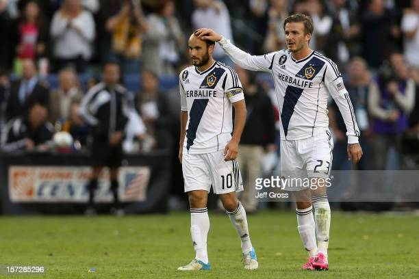 Landon Donovan and David Beckham of Los Angeles Galaxy celebrate in the second half against the Houston Dynamo in the 2012 MLS Cup at The Home Depot...