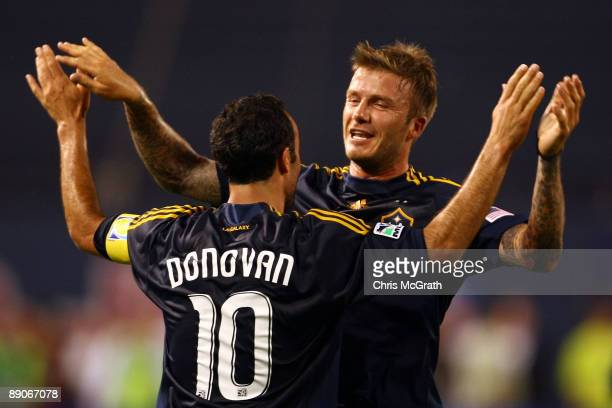 Landon Donovan and David Beckham of the LA Galaxy celebrate a goal in the first half by teammate Eddie Lewis during the game against the New York Red...