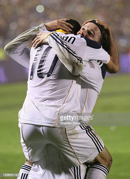 Landon Donovan and David Beckham of the Los Angeles Galaxy celebrate after defeating the Houston Dynamo 10 in the 2011 MLS Cup at The Home Depot...