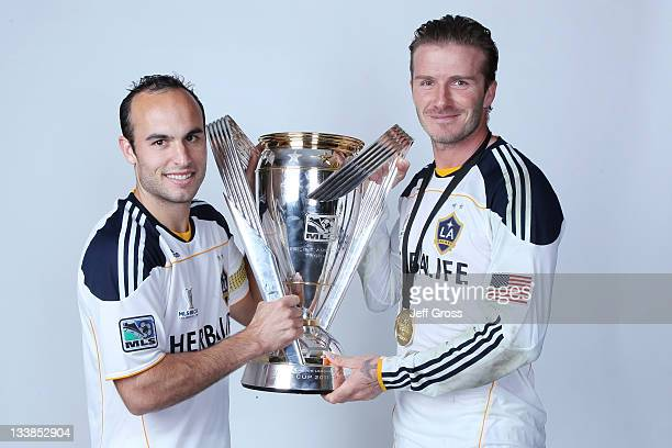 Landon Donovan and David Beckham of the Los Angeles Galaxy pose for a portrait following the 2011 MLS Cup at The Home Depot Center on November 20...