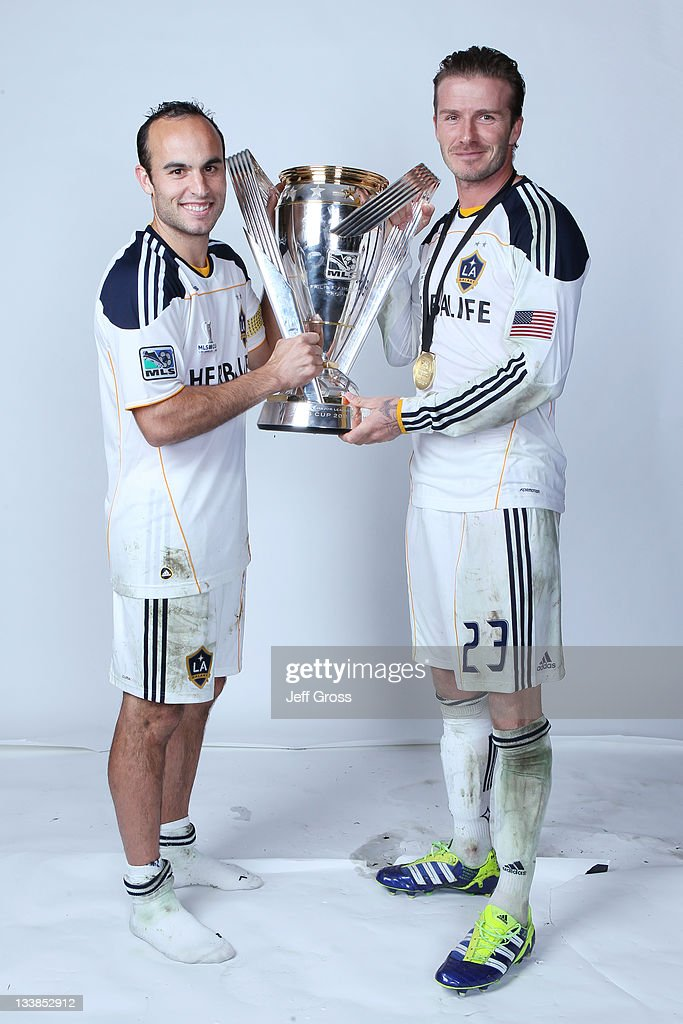 Landon Donovan #10 and David Beckham #23 of the Los Angeles Galaxy pose for a portrait following the 2011 MLS Cup at The Home Depot Center on November 20, 2011 in Carson, California.