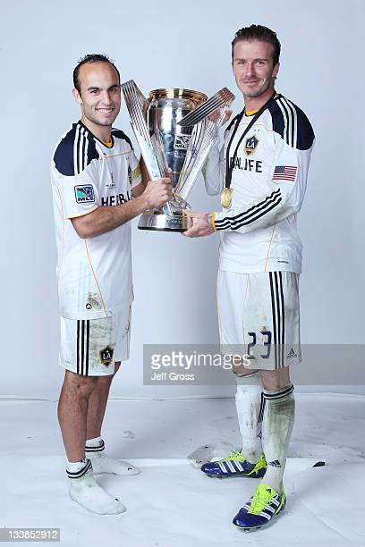 Landon Donovan and David Beckham of the Los Angeles Galaxy pose for a portrait following the 2011 MLS Cup at The Home Depot Center on November 20,...