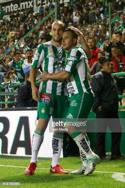Landon Donovan and Luis Montes of Leon celebrate after the 6th round match between Leon and Puebla as part of the Torneo Clausura 2018 Liga MX at...