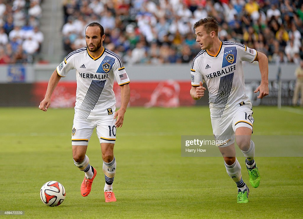 Landon Donovan #10 and Robbie Rogers #14 of Los Angeles Galaxy set up a play during the game against the Seattle Sounders FC during the Western Conference Final at StubHub Center on November 23, 2014 in Los Angeles, California.