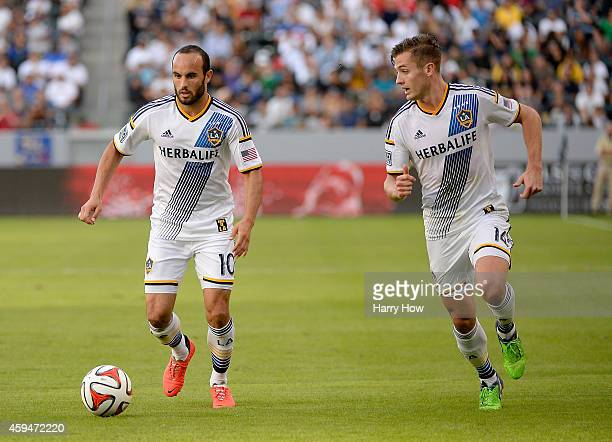 Landon Donovan and Robbie Rogers of Los Angeles Galaxy set up a play during the game against the Seattle Sounders FC during the Western Conference...