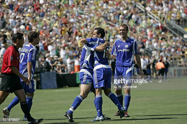 Landon donovan hugs Taylor Twellman after an MLS score during the MLS All Star game featuring the MLS All Stars vs. Fulham FC at Crew Stadium in...