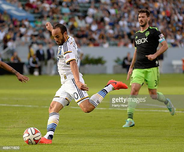 Landon Donovan of Los Angeles Galaxy attempts a shot in front of Brad Evans of Seattle Sounders FC during the Western Conference Final at StubHub...