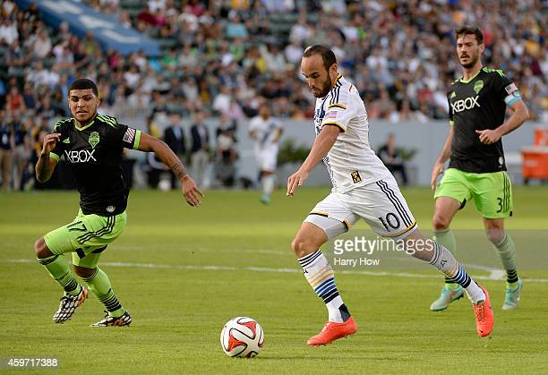 Landon Donovan of Los Angeles Galaxy attempts a shot in front of Deindre Yedlin and Brad Evans of Seattle Sounders FC during the Western Conference...