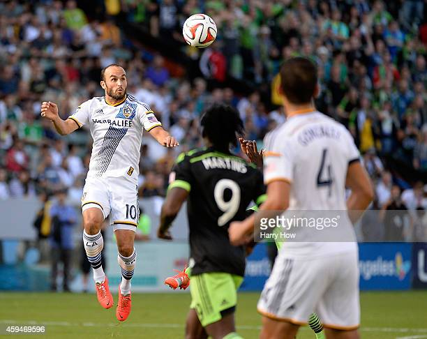 Landon Donovan of Los Angeles Galaxy heads the ball in front of Obafemi Martins of Seattle Sounders FC and Omar Gonzalez during the Western...