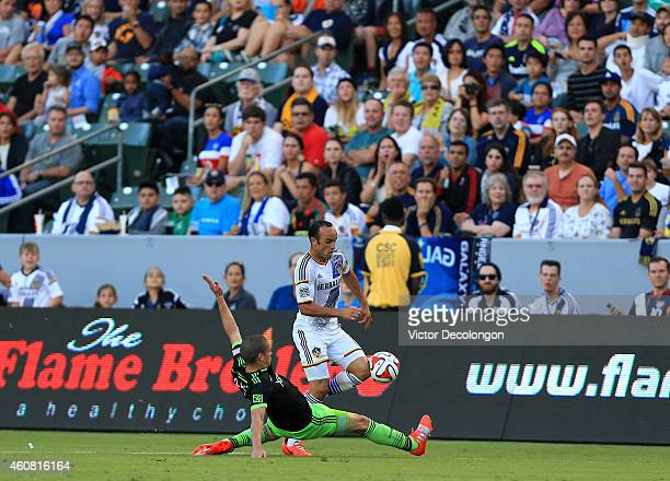Landon Donovan of Los Angeles Galaxy plays the ball against Osvaldo Alonso of Seattle Sounders FC during the MLS match at StubHub Center on October...