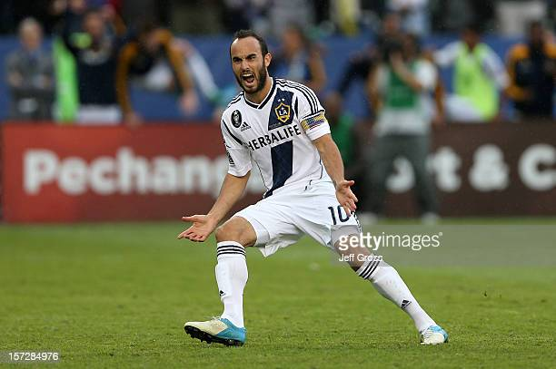Landon Donovan of Los Angeles Galaxy reacts after scoring on a penalty kick in the second half against the Houston Dynamo in the 2012 MLS Cup at The...