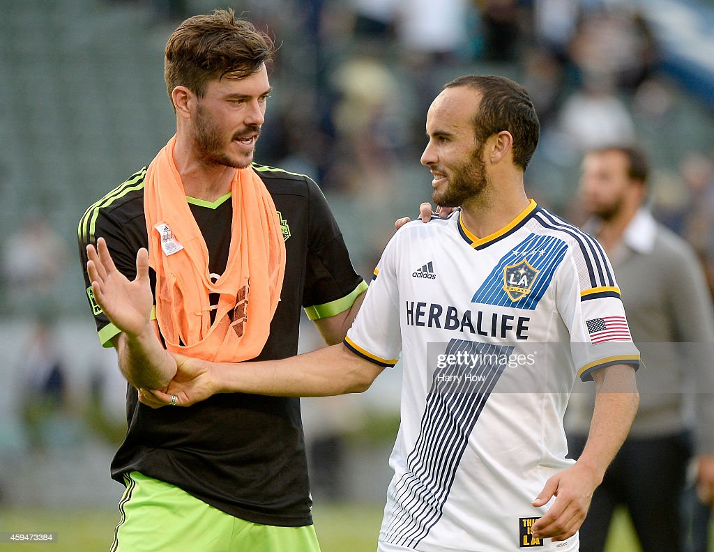 Landon Donovan #10 of Los Angeles Galaxy receives congratulatory handshake from Brad Evans #3 of Seattle Sounders FC after a 2-1 Galaxy win during the Western Conference Final at StubHub Center on November 23, 2014 in Los Angeles, California.