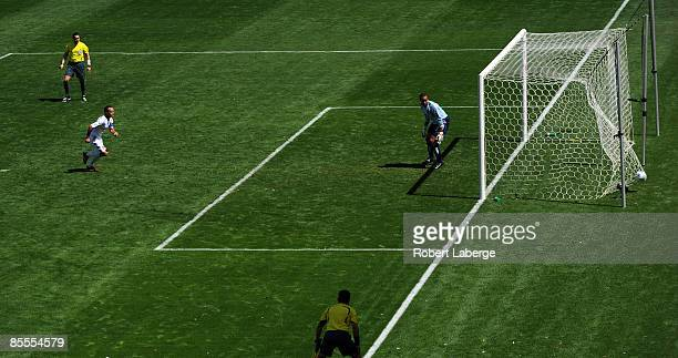 Landon Donovan of Los Angeles Galaxy scores his first goal of the game on a penalty kick against Josh Wicks of D C United at the Home Depot Center on...