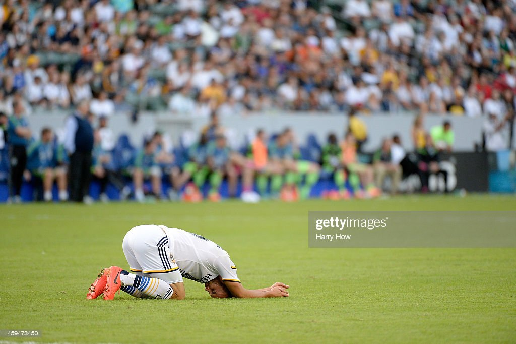Landon Donovan #10 of Los Angeles Galaxy stays on the ground after a collision with a Seattle Sounders FC player during a 2-1 Galaxy win in the Western Conference Final at StubHub Center on November 23, 2014 in Los Angeles, California.