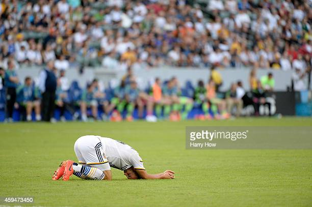 Landon Donovan of Los Angeles Galaxy stays on the ground after a collision with a Seattle Sounders FC player during a 21 Galaxy win in the Western...