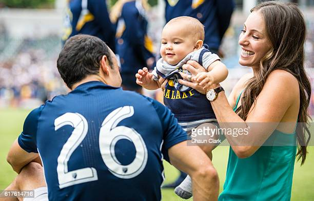 Landon Donovan of Los Angeles Galaxy with his son Talon and his wife Hannah following the Los Angeles Galaxy's MLS match against FC Dallas at the...