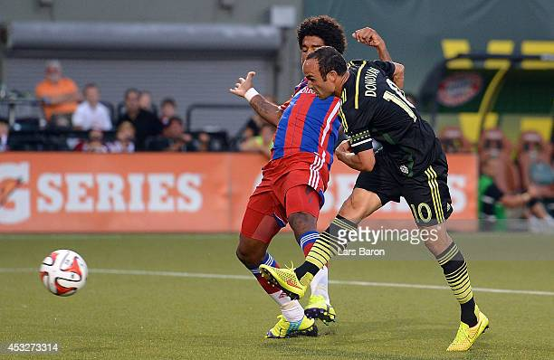 Landon Donovan of MLS All-Stars scores his teams second goal against Dante of Muenchen during the MLS All-Star game between the MLS All-Stars and FC...