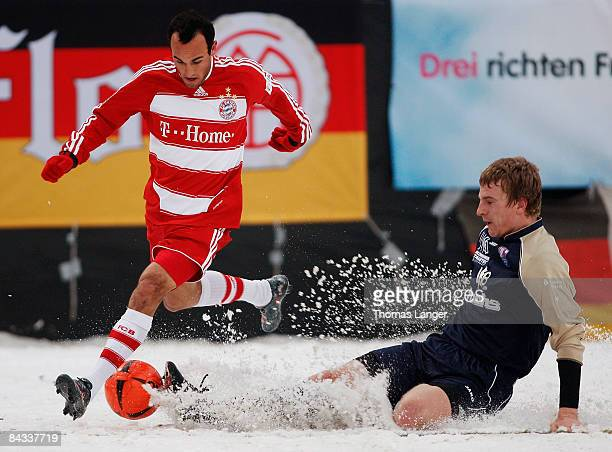 Landon Donovan of Munich and Juergen Dennerlein of Bamberg battle for the ball during the friendly match between FC Eintracht Bamberg and FC Bayern...