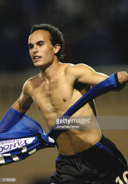 Landon Donovan of the Earthquakes removes his jersey in celebration of scoing the winning golden goal in overtime during the MLS Western Conference...