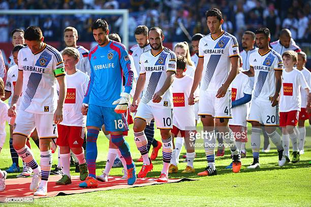 Landon Donovan of the Los Angeles Galaxy and his teammates walk onto the field prior to the 2014 MLS Cup match between the New England Revolution and...