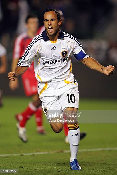 Landon Donovan of the Los Angeles Galaxy celebrates after converting on a penalty kick in the second half against Toronto FC during their MLS match...