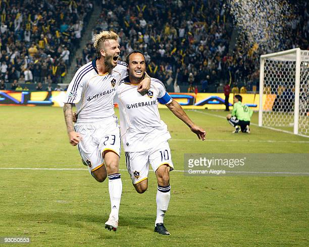 Landon Donovan of the Los Angeles Galaxy celebrates his goal scored against the Houston Dynamo with his teammate David Beckham during the 2009 MLS...