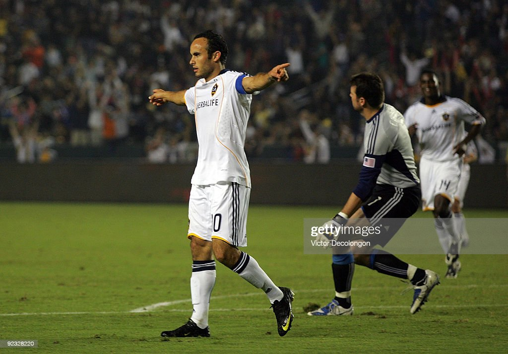 Landon Donovan #10 of the Los Angeles Galaxy celebrates his second goal of the game in the second half as goalkeeper Joe Cannon #1 of the San Jose Earthquakes looks on dejectedly during the MLS match at The Home Depot Center on October 24, 2009 in Carson, California. The Galaxy defeated the Earthquakes 2-0.