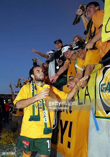 Landon Donovan of the Los Angeles Galaxy celebrates with fans after defeating the New England Revolution 10 in overtime to win MLS Cup 2005 at Pizza...