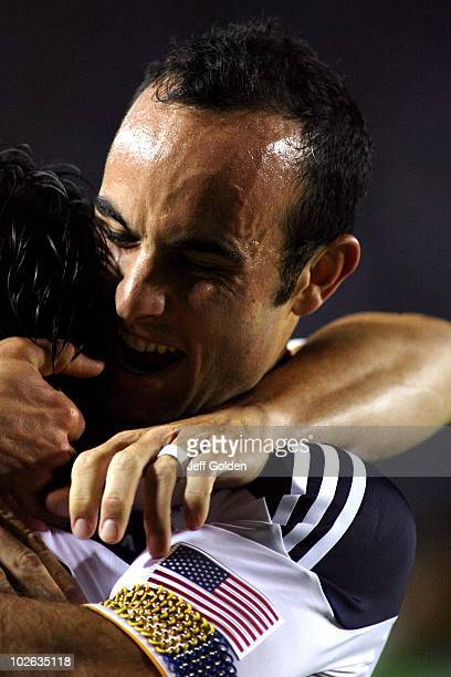 Landon Donovan of the Los Angeles Galaxy celebrates with teammate Alan Gordon after an own goal against the Seattle Sounders FC on July 4 2010 at the...