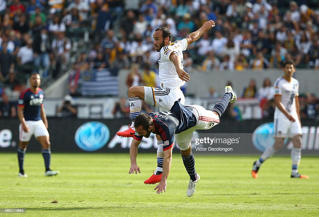 Landon Donovan #10 of the Los Angeles Galaxy clashes with A.J. Soares #5 of the New England Revolution in the first half during the 2014 MLS Cup match at StubHub Center on December 7, 2014 in Los Angeles, California.