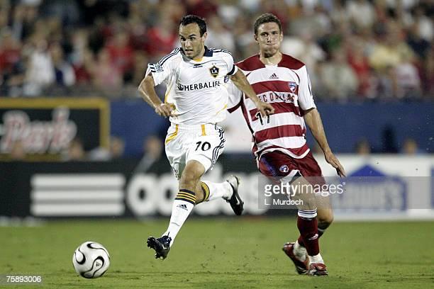 Landon Donovan of the Los Angeles Galaxy dribbles the ball past Aaron Pitchkolan of FC Dallas during a SuperLiga match July 31, 2007 at Pizza Hut...