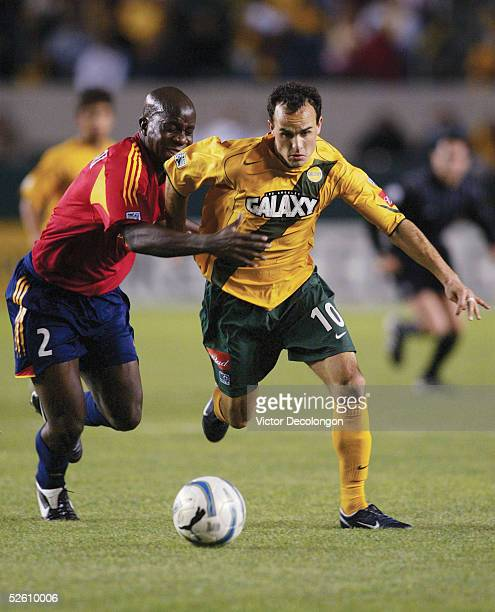 Landon Donovan of the Los Angeles Galaxy fights through the challenge of Nelson Akwari of Real Salt Lake during the first half of their major league...