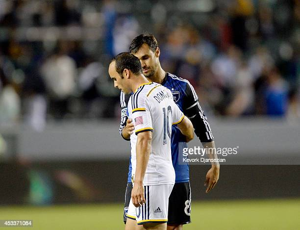 Landon Donovan of the Los Angeles Galaxy gets a hug from Chris Wondolowski of the San Jose Earthquakes at the conclusion of their soccer match at the...