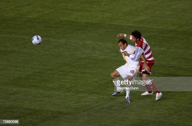 Landon Donovan of the Los Angeles Galaxy holds off a challenge by Marcelo Saragosa of FC Dallas during the first half of their MLS match at The Home...