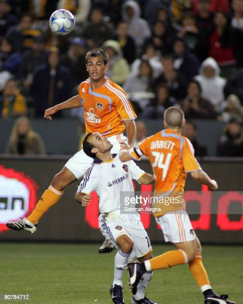 Landon Donovan of the Los Angeles Galaxy in action against Patrick Ianni of the Houston Dynamo during the game at Home Depot Center on April 19 2008...