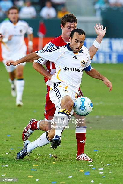 Landon Donovan of the Los Angeles Galaxy in action against the defense of FC Dallas during their match at Home Depot Center on September 23 2007 in...