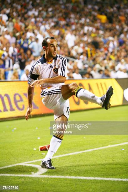 Landon Donovan of the Los Angeles Galaxy in action against the defense of Pachuca during their Superliga Final match at Home Depot Center on August...