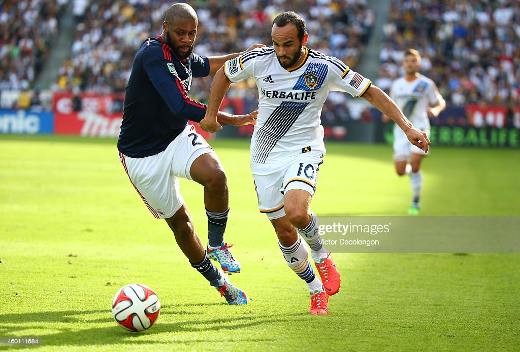 Landon Donovan #10 of the Los Angeles Galaxy plays the ball past Andrew Farrell #2 of the New England Revolution in the first half during the 2014 MLS Cup match at StubHub Center on December 7, 2014 in Los Angeles, California.