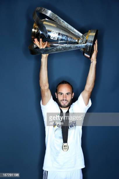 Landon Donovan of the Los Angeles Galaxy poses after winning the 2012 MLS Cup 3-1 against the Houston Dynamo at The Home Depot Center on December 1,...