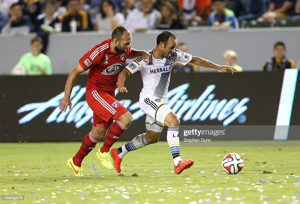 Landon Donovan #10 of the Los Angeles Galaxy races for the ball with Adam Moffat #6 of FC Dallas at StubHub Center on September 20, 2014 in Los Angeles, California.