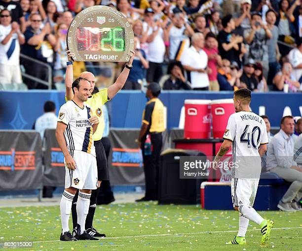 Landon Donovan of the Los Angeles Galaxy replaces Raul Mendiola as he returns to the game from retirement against the Orlando City FC at StubHub...