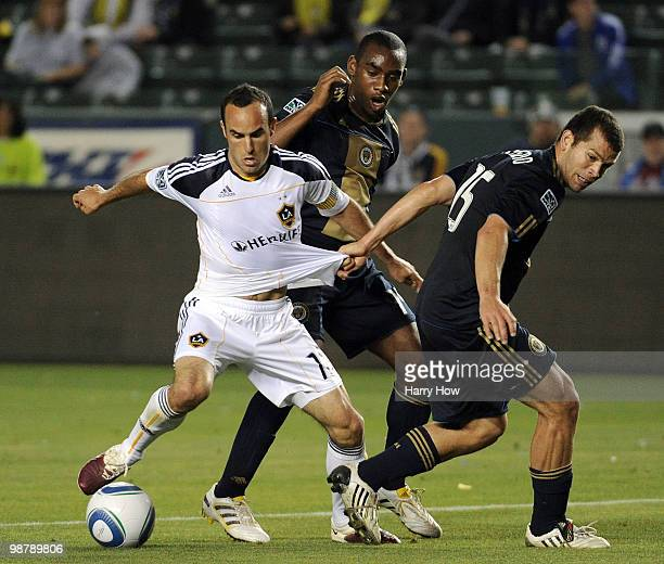 Landon Donovan of the Los Angeles Galaxy spins free from Alejandro Moreno and Amobi Okugo of the Philadelphia Union during the second half at the...